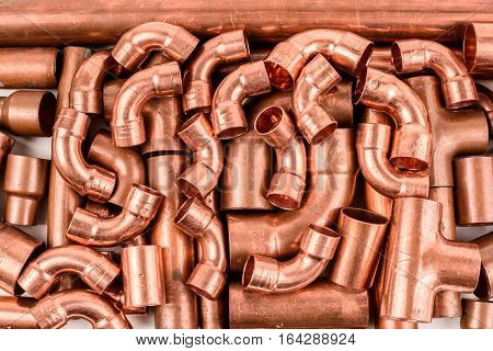 Copper elbow and T-piece copper pipe industrial background