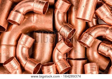 Installation material copper elbow and pipe industrial background