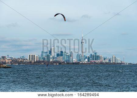 Kitesurfing in Ontario lake in winter day