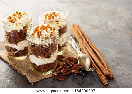 Carrot cake in a jar with pecan nuts and cinnamon