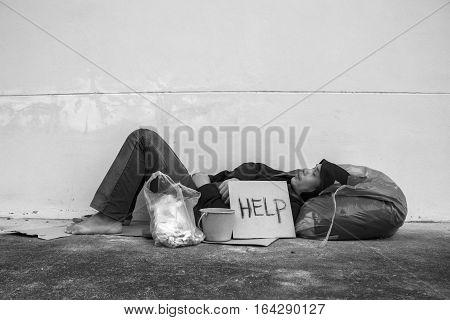 Homeless person sleep on sidewalk of the street