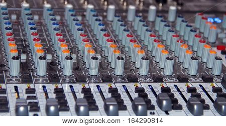 Large mixing console shot close-up during the operation