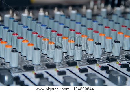 A mixing console shot in studio closeup