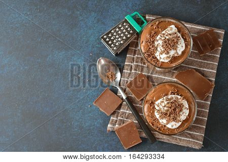 French chocolate mousse in a glass topped with whipped cream