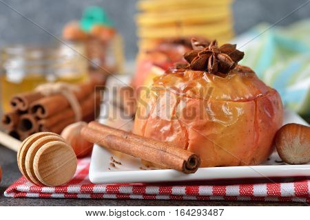 Baked apples with spices on a brown background