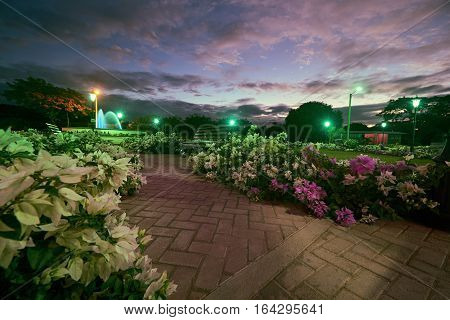 Park with flowers and bench in sunset time Leon Nicaragua