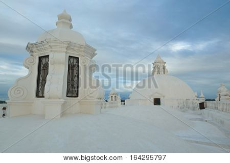 Towers on white church roof in cathedral Leon Nicaragua. White roof