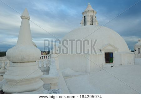 Church with white roof in sunset time Leon Nicaragua