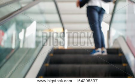 Blured movement of abstract escalator with people
