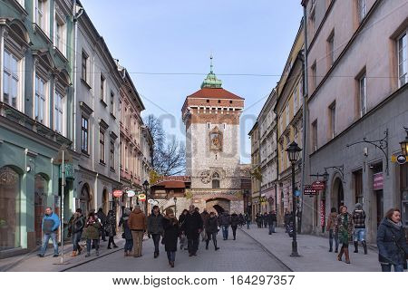 POLAND KRAKOW - JANUARY 03 2015: Medieval tower of the Florian Gate at winter in historical part of town. Krakow is the second largest and one of the oldest cities in Poland.