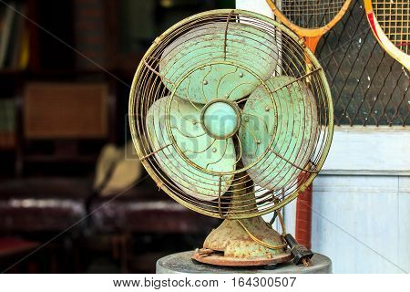 Old or vintage electric fan on the table.