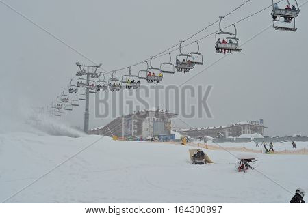 ski lift, chairlift against grey sky background. Winter sport