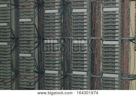 telephone patch panel in datacenter server room, a plurality of cables