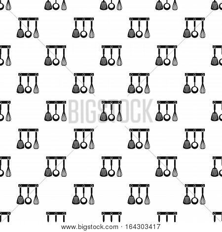 Spatula, whisk and ladle on hanger pattern. Simple illustration of spatula, whisk and ladle on hanger vector pattern for web