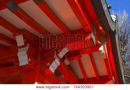 Ceiling of a red Shinto inari shrine.