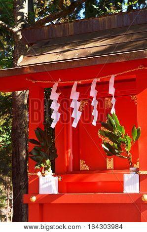 Small red kamidana shinto shrine in Japan
