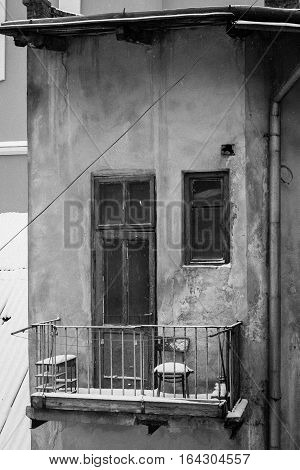 Poverty - chair on the balcony of abandoned house - cold winter