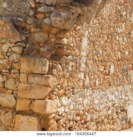 Old wall of limestone rocks on Crete Greece.