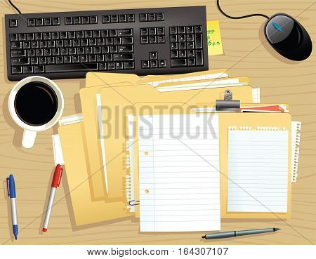 An over head view of a typical stack of files on an office desk. Plenty of blank space for your own message.