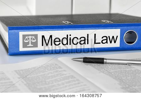 Blue Folder With The Label Medical Law