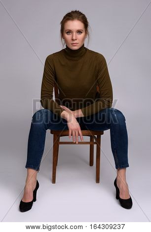 Pretty Woman Sits On Chair
