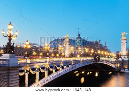 The bridge Alexandre III is a deck arch bridge that spans the Seine in Paris. It is widely regarded as the most ornate extravagant bridge in the city. It is classified as French historic monument.
