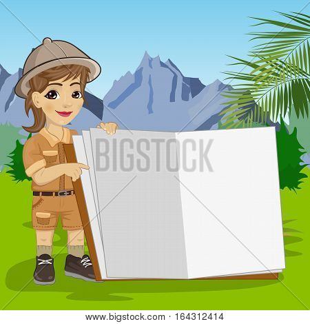 cute little explorer girl in a safari outfit showing giant book open in the jungle