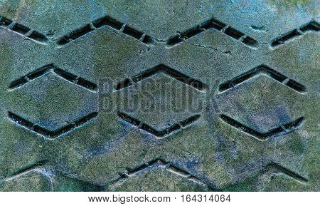 Old grunge colorful tire tread background .