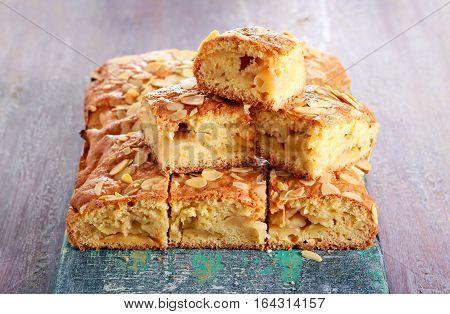 Devonshire apple cake sliced on board selective focus