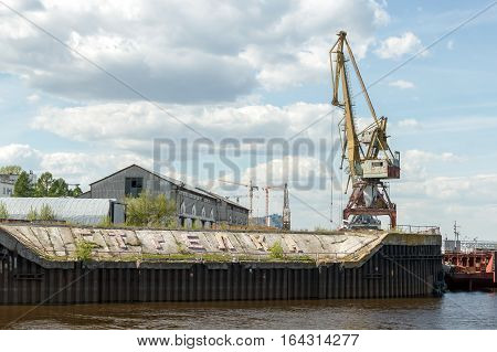 Strelka Nizhny Novgorod. Port cranes and buildings of the cargo river port. View from the Volga River