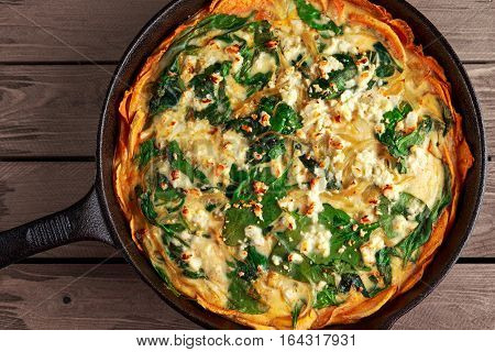 Home made Spinach quiche in a sweet potato crust with feta cheese.