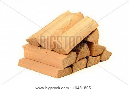 Firewood lying upon another isolated on white background
