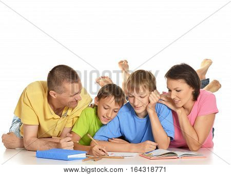 family doing homework  together, posing on white