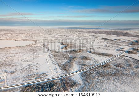 Highway in the winter tundra aerial view