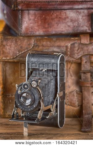 Vintage photo camera and travel in bag