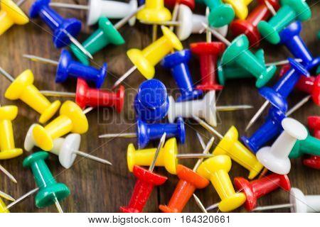 Various Color Thumbtacks  On Distressed Wood