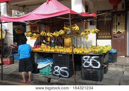 Shopper At A Market Fruit Stall In Jalan Burma, Penang