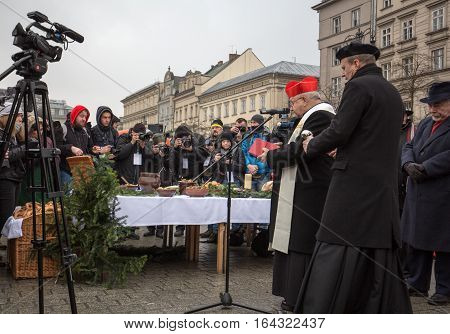 CRACOW POLAND - DECEMBER 18 2016: Cardinal Stanislaw Dziwisz during Christmas Eve for poor and homeless on the Central Market in Cracow.