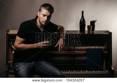 Man With Glass Near Wood Piano