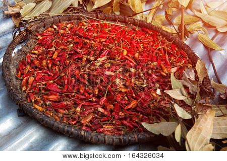 dry red chili pepper in the basket on asia market