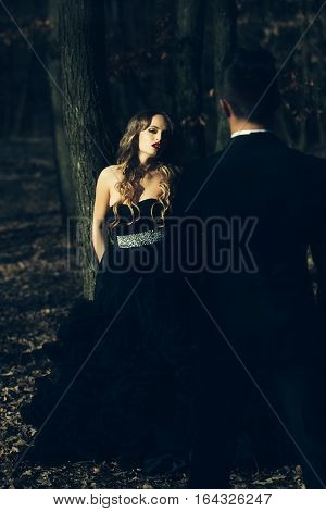 Elegant Young Couple In Forest