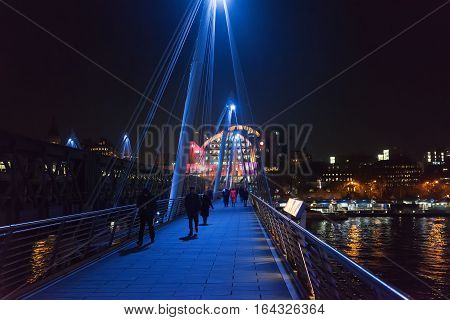 London, UK. 5th January 2017. The Hungerford footbridge with Charing Cross railway station to the side and the River Thames running underneath it. The weather is cold.