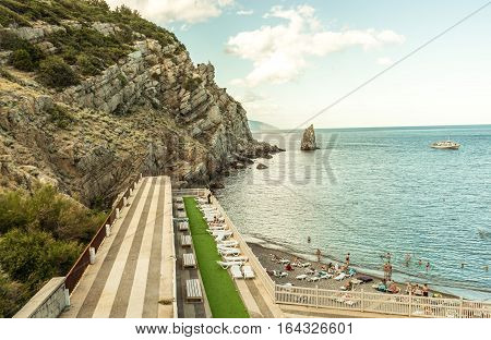 Detached private beach on the southern coast of Crimea. Foto with retro effect