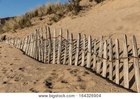 Fence on the beach of la Mine in Jard-sur-Mer (Vendee, France)
