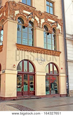 KRAKOW, POLAND - JANUARY 04, 2011: Hard Rock Cafe in Krakow is located in the UNESCO World Heritage Market Square next door to the most famous church in Poland St. Mary's Basilica. Cafe has room for 130 guests over three spacious floors