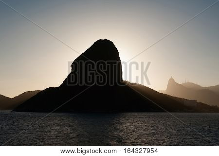 Sugar loaf and Corcovado in backlit from the sea