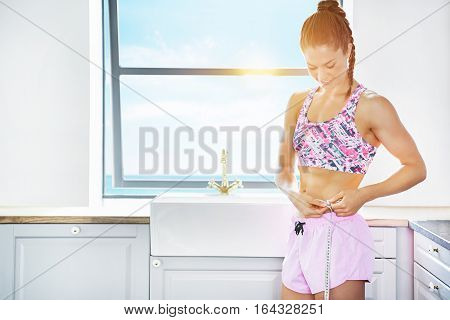 Woman In Sunlight Doing Measures Of Waist