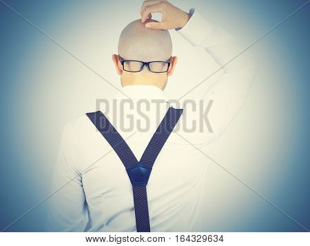 Back Of A Bald-headed Man With Glasses On Nape