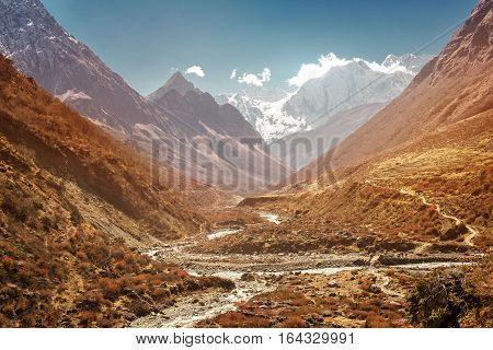 River in Nepal mountains, Manaslu mountain peak covered by snow