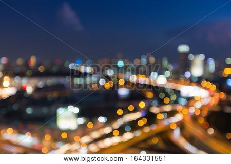 Abstract blurred lights city downtown and highway road interchanged night view